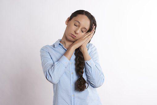woman asleep while standing